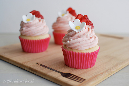 http://theculinarychronicles.com/2013/11/13/we-just-turned-f-o-u-r-strawberry-shortcake-cupcakes/
