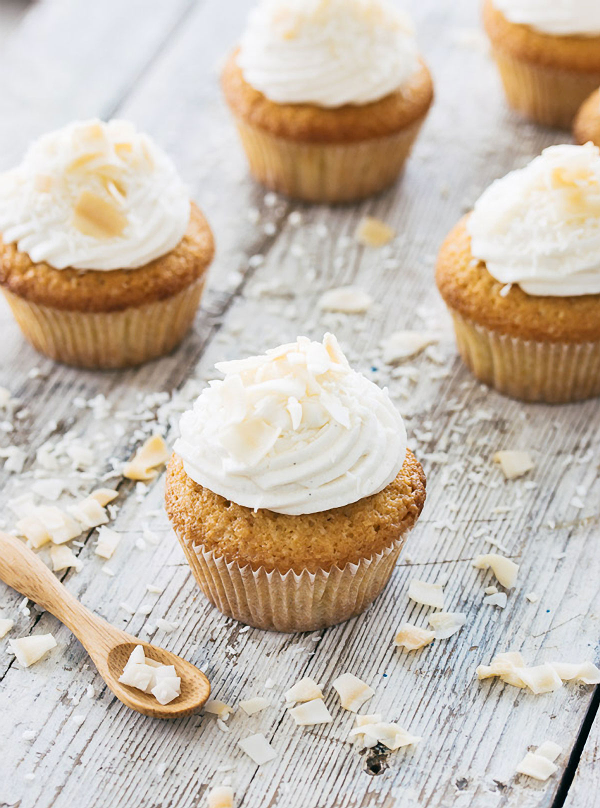 Coconut cupcakes topped with vanilla cream cheese frosting