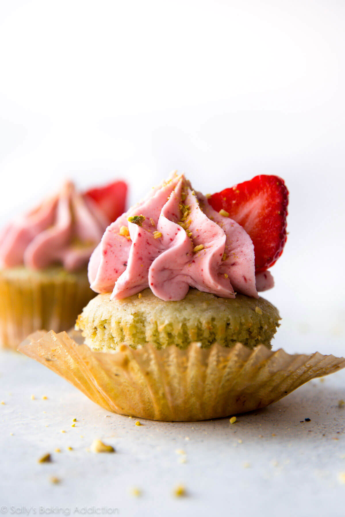 Pistachio Cupcakes with Creamy Strawberry Frosting