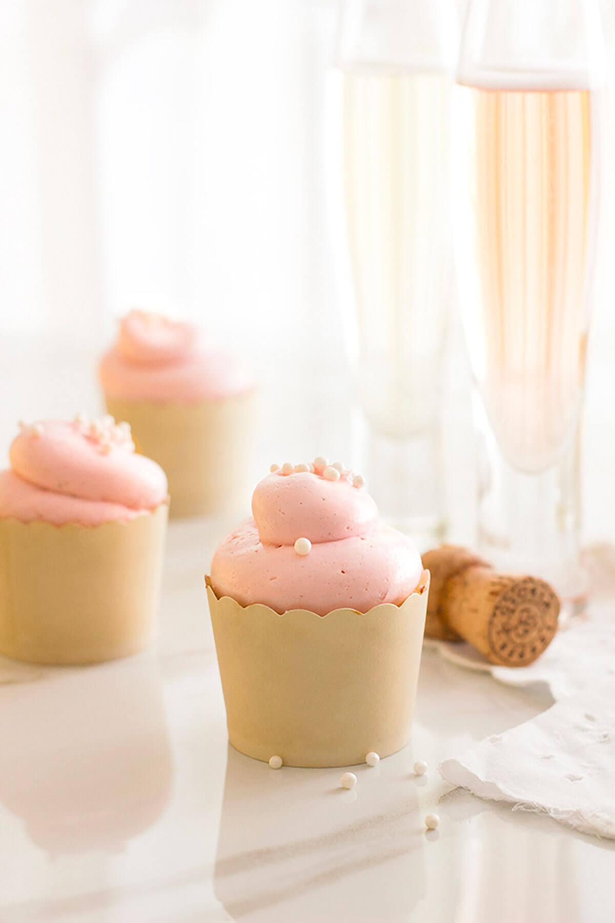Vanilla Bean & Almond Cupcakes with Roasted Raspberry Swiss Meringue Buttercream